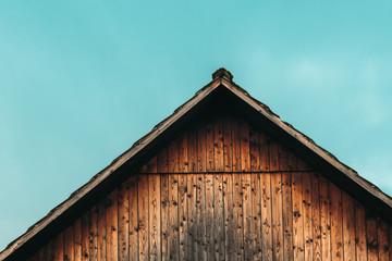 Fototapeta Gable shed roof and blue sky obraz