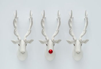 Christmas reindeer decoration with red Christmas bauble. Creative minimal funny holiday concept.