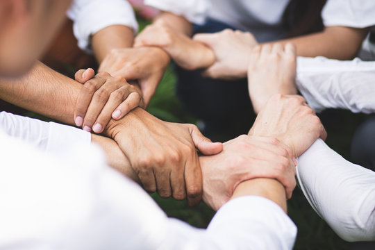 Group people hands were collaboration to trust in business success concept of teamwork partnership in company. Victory as a team, fighting for the success of the organization concept.