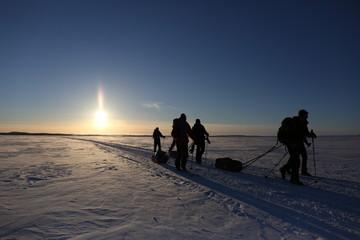 Ski expedition in Inari Lake, Lapland, Finland