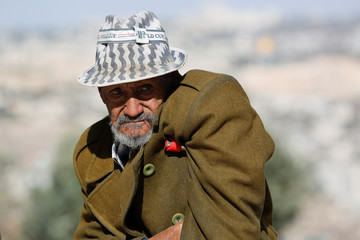 An Israeli Ethiopian man looks on during a ceremony marking the Ethiopian Jewish holiday of Sigd in Jerusalem
