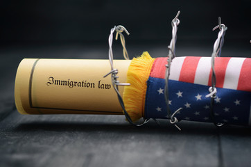 Barbed wire , Immigration Law and flag of United States Of America stock photo