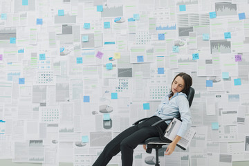 Exhausted businesswoman overwhelmed by work