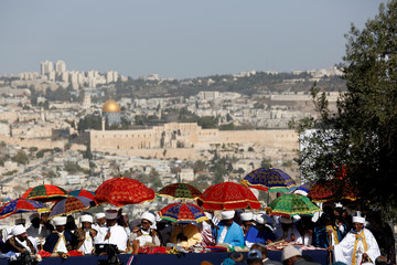 A general view shows the Dome of the Rock in the background as Kessim, religious leaders of the Israeli Ethiopian community take part in a ceremony marking the Ethiopian Jewish holiday of Sigd in Jerusalem