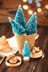 Artificial little Christmas treees in biodegradable peat moss and wooden shavings. Eco-friendly New Year and Christmas