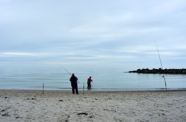 A pair fishing on the coast of the baltic sea on the Darß peninsula