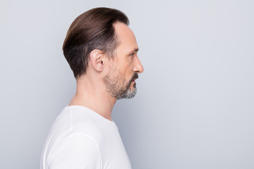 Closeup profile photo of handsome aged man seriously looking side empty space mature wrinkles think about anti age cream wear white t-shirt isolated grey color background Fototapete