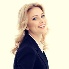 Portrait of happy smiling beautiful young businesswoman in confident style black suit. Caucasian blond model in business success concept.