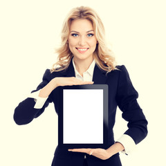 Portrait of businesswoman in confident style black suit, showing blank no-name tablet pc monitor with copy space area for slogan or text message. Caucasian blond model in business concept shoot.