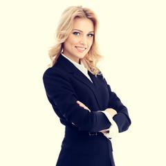 Portrait of happy smiling beautiful businesswoman in confident style black suit. Caucasian blond model in business success concept.