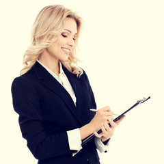 Portrait of businesswoman in confident style black suit with clipboard writing. Caucasian blond model in business success concept. Copyspace empty area for some text message or advertise slogan.