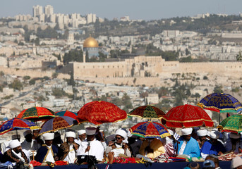 General view shows the Dome of the Rock in the background as Kessim, religious leaders of the Israeli Ethiopian community take part in a ceremony marking the Ethiopian Jewish holiday of Sigd in Jerusalem