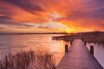Boardwalk over water at sunrise, near Amsterdam The Netherlands