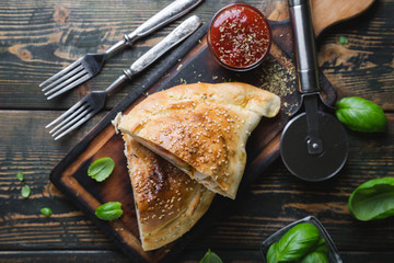 Calzone pizza with chicken and cheese