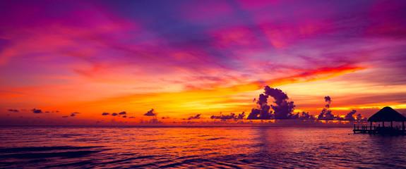 Foto op Aluminium Zee zonsondergang sun sea tropical sunset view of the pier of the caribbean