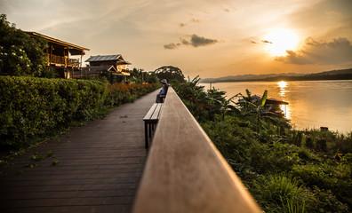 Papiers peints Brun profond Road, river, scenery, Mekong, evening In Chiang Khan, Loei, Thailand