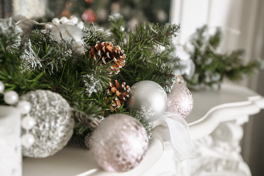 Christmas tree decorated with toys in silver and pink color. In it we see the balloons with of ribbons, stick figure deer, beads and lights glowing garland, Christmas Tree is Ready for the Holiday