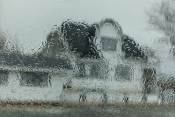Garden Poster Water Motor sports Dwelling house through wet window, winter day