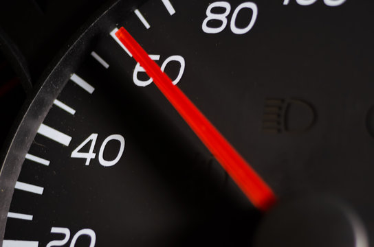 Close-up of the car speed meter. Car speedometer close up, speed 60