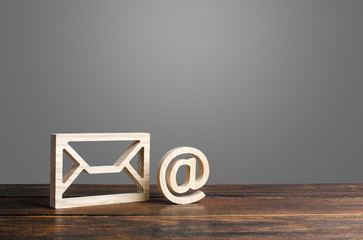 Email symbol at commercial and envelope. internet correspondence. Contacts for business. Internet and global communication technologies, digitalization of economy and processes.