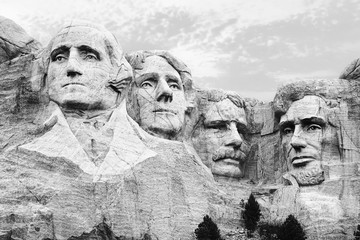 A closeup of the four heads of USA presidents at Mount Rushmore South Dakota in black and white