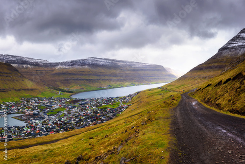 Wall mural City of Klaksvik with a dirt road on Faroe Islands, Denmark