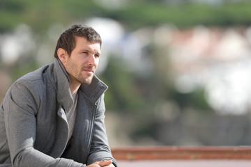 Serious pensive man contemplating views in winter Fotomurales