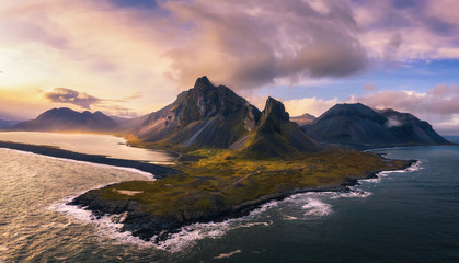 Canvas Prints Northern Europe Aerial View of the Eystrahorn with Krossanesfjall Mountain in Iceland at sunset