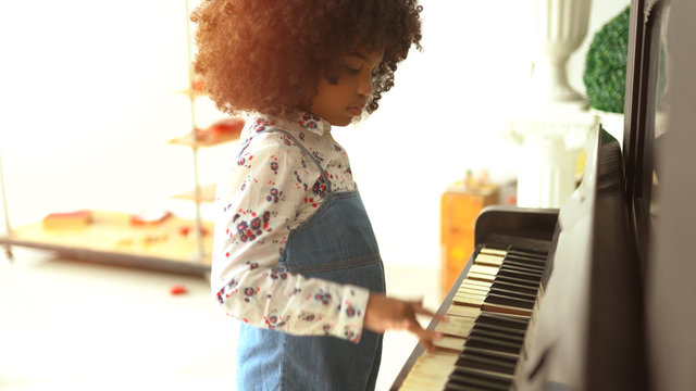 African kids are playing on piano music