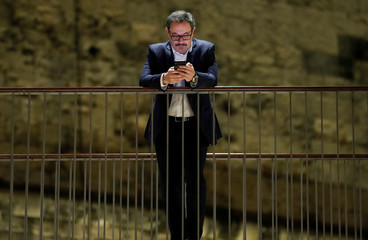 Parliamentary Secretary for Persons with Disability and Active Ageing Anthony Agius Decelis checks his mobile phone at the Parliament, in Valletta