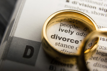 Divorce and separation concept. Two golden wedding rings. Dictionary definition.