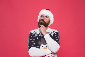 What if. Hipster bearded man wear winter sweater and hat. Happy new year. Winter plan. Man thoughtful face expression. Hard decision. Decision making. Make christmas wish. Life changing decision