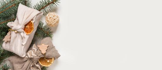 Zero waste, Christmas eco-friendly gift wrapping in traditional Japanese Furoshiki style,...