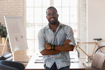 Smiling confident african american young businessman portrait.