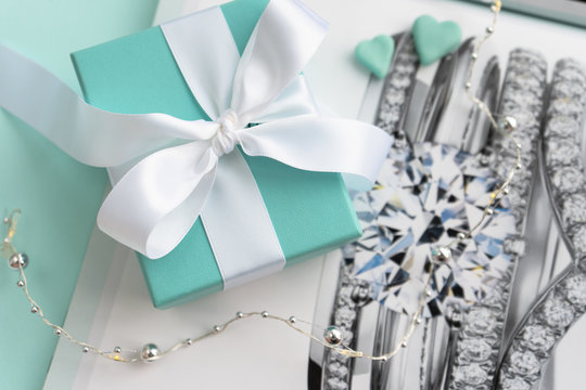 Minsk, Belarus. November, 2019: Luxury, trendy jewelry Tiffany box.  The world-famous American fashion brand. Silver and gold jewelry - best present for every holiday.