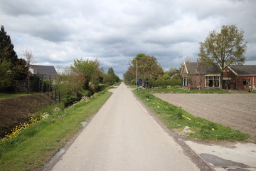 Small country road named Knibbelweg in the lowest polder of western Europe in Zevenhuizen, the Netherlands