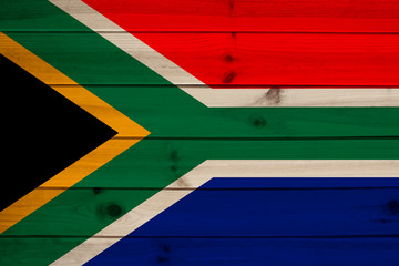 photo of the beautiful colored national flag of the state of South Africa, concept of tourism, economy and politics, closeup