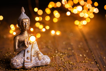 Buddha statue with magical lights on wooden background - Religion, Buddhism