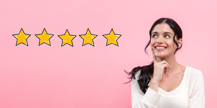 Five star rating with young woman in thoughtful pose