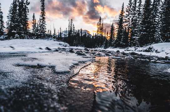 Sunset reflecting off partially frozen river
