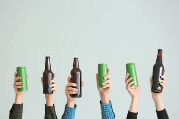 Poster Alcohol Hands with different beer on grey background
