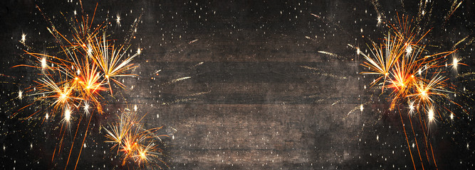 Silvester background panorama long - Firework on rustic brown wooden texture with space for text Fotomurales