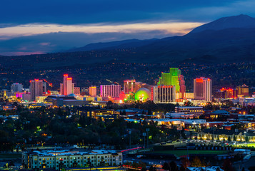USA, NEVADA, RENO - OCTOBER 30, 2014: Reno skyline on October 30, 2014. It's known as The Biggest Little City in the World, famous for casinos and the birthplace of the gaming Harrah's Entertainment.