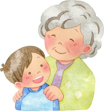 子供の肩に手を置くおばあさん