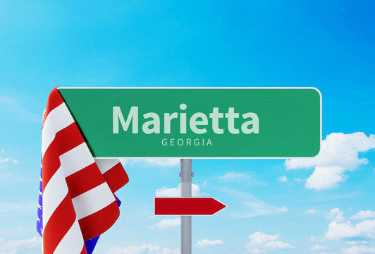 Marietta – Georgia. Road or Town Sign. Flag of the united states. Blue Sky. Red arrow shows the direction in the city. 3d rendering