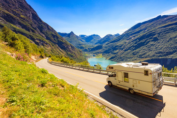 Geiranger fjord and camper on road, Norway.