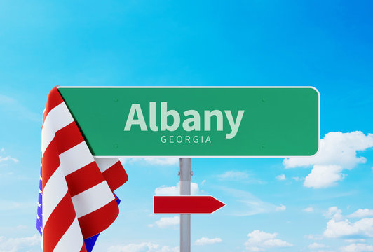 Albany – Georgia. Road or Town Sign. Flag of the united states. Blue Sky. Red arrow shows the direction in the city. 3d rendering
