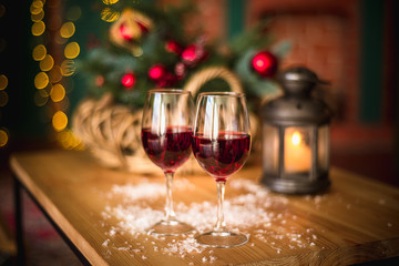 Fototapeten Alkohol Two red wine glass on wooden loft table decorated christmas garland and lantern
