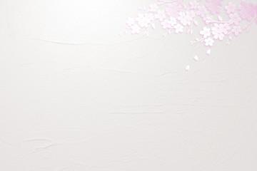 Wall Mural - 桜の花びらと白い壁の背景