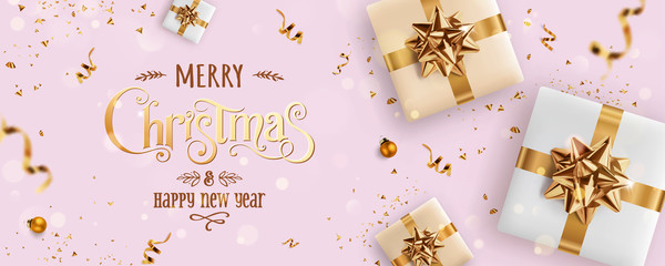 Fototapete - Gold Christmas and New Year Text on pink Xmas background with gift boxes, fir branches, gold ribbon, decoration, sparkles,confetti